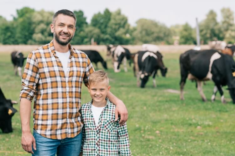 Father and Son in Cow Pasture,AWest Security, Bismarck,  ND